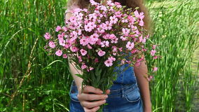 Young beautiful woman give pink flowers bouquet as gift stock video footage