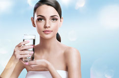 Young beautiful woman with glass of clear water, healthy life concept Royalty Free Stock Photo