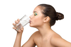 Young beautiful woman with glass of mineral water Royalty Free Stock Image