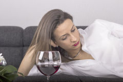 Young beautiful woman with glass of red wine Stock Photography