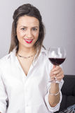 Young beautiful woman with glass of red wine Royalty Free Stock Images