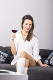 Young beautiful woman with glass of red wine Stock Photo