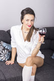 Young beautiful woman with glass of red wine Stock Photos