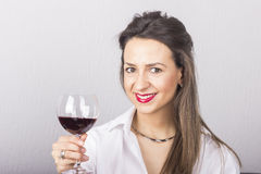 Young beautiful woman with glass of red wine Stock Images