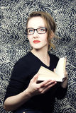Young beautiful woman in glasses with  book Stock Photography