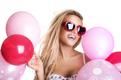 Young beautiful woman with glasses holding pink balloons, valent Stock Photos