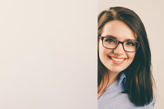 Young beautiful woman in glasses holding white blank board Stock Images
