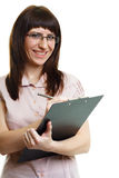 Young beautiful woman in glasses with a pen and documents Royalty Free Stock Photo