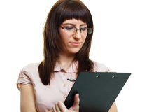 Young beautiful woman in glasses with a pen and documents Royalty Free Stock Photos