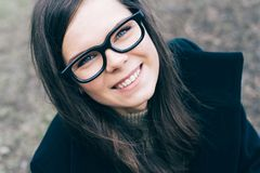 Young beautiful woman with glasses stock photo