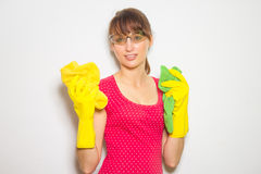 Young beautiful woman with gloves and cloth isolated on white. Stock Photography