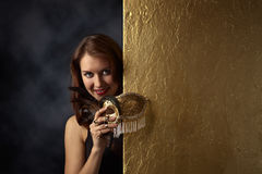 Young beautiful woman with golden carnival mask Royalty Free Stock Photo