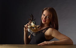 Young beautiful woman with golden carnival mask Stock Image