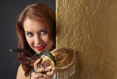 Young beautiful woman with golden carnival mask Royalty Free Stock Photography