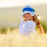 Young beautiful woman on golden cereal field Stock Photos