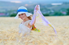 Young beautiful woman on golden cereal field Stock Photography