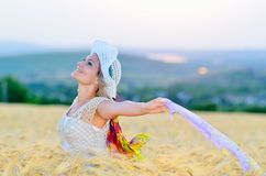 Young beautiful woman on golden cereal field Stock Image