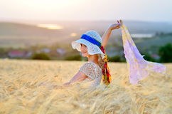 Young beautiful woman on golden cereal field Stock Images