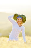 Young beautiful woman on golden cereal field in summer Royalty Free Stock Photography