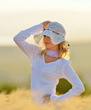 Young beautiful woman on golden cereal field in summer Royalty Free Stock Image