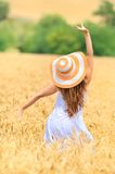 Young beautiful woman in golden wheat field Royalty Free Stock Photography