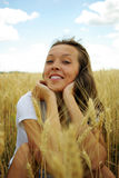 Young beautiful woman in golden wheat field Royalty Free Stock Image