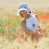 Young beautiful woman on golden wheat field Royalty Free Stock Photos