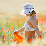 Young beautiful woman on golden wheat field Royalty Free Stock Photography