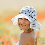 Young beautiful woman on golden wheat field in summer Stock Images