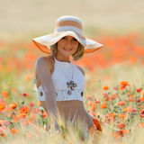 Young beautiful woman on golden wheat field in summer Stock Photography
