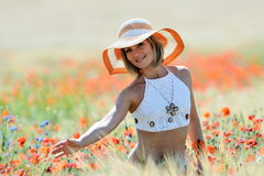 Young beautiful woman on golden wheat field in summer Royalty Free Stock Images