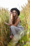 Young beautiful woman in golden wheat field Stock Photos