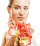 Young beautiful woman and gorgeous pink flower Stock Photos