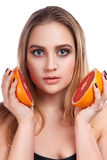 Young beautiful woman with grapefruit Royalty Free Stock Photography