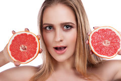 Young beautiful woman with grapefruit Royalty Free Stock Photos
