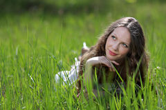 Young beautiful woman in grass Stock Photos