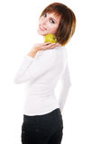 Young beautiful woman with a green apple Stock Photography