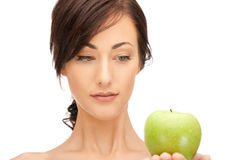 Young beautiful woman with green apple Stock Photos