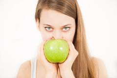 A young beautiful woman with a green apple Stock Image