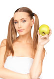 Young beautiful woman with green apple Royalty Free Stock Images