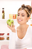 Young beautiful woman with green apple Stock Images