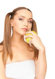 Young beautiful woman with green apple Royalty Free Stock Image