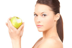 Young beautiful woman with green apple Royalty Free Stock Photos