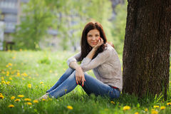Young beautiful woman , on green background summer nature. Royalty Free Stock Photo