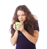 Young beautiful woman with a green cup Royalty Free Stock Image