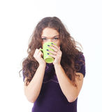 Young beautiful woman with a green cup Royalty Free Stock Images