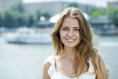 Young beautiful woman in green dress posing outdoors in sunny we Royalty Free Stock Photography