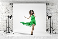 Young beautiful woman in green dress Royalty Free Stock Photography