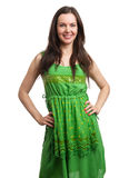 Young beautiful woman in green dress smiling Stock Image