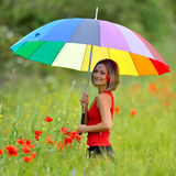 Young beautiful woman on green field in summer Royalty Free Stock Image